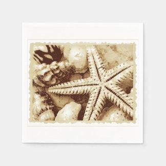 Serviettes de papier d'étoiles de mer et de serviettes en papier