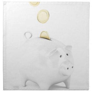 Serviettes En Tissus Tirelire avec les pièces de monnaie d'or