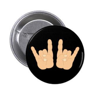 Signe de main de rock badges
