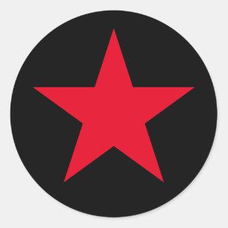 Signe rouge de symbole d'étoile de guerre sticker rond