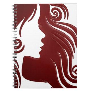 Silhouette de femme (arrière - plan rougeâtre carnets à spirale