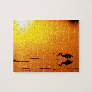 Silhouette de héron au coucher du soleil, la puzzle