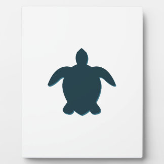 Silhouette de tortue de mer avec l'ombre plaque photo