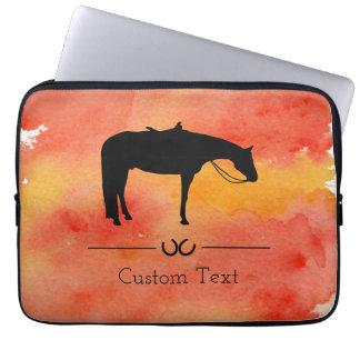 Silhouette occidentale noire de cheval sur housse pour ordinateur portable