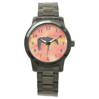 Silhouette occidentale noire de cheval sur montres bracelet