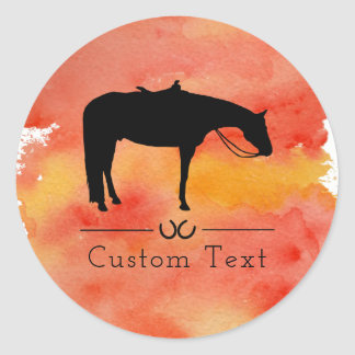 Silhouette occidentale noire de cheval sur sticker rond