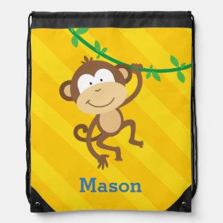 Singe drôle dans le sac à dos de cordon de jungle