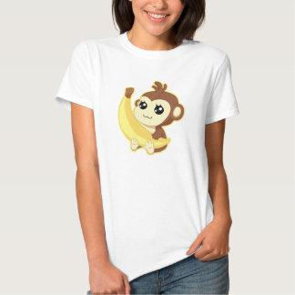 Singe mignon de Kawaii tenant la banane T-shirts