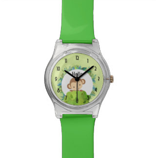 Singe mignon jetant un coup d'oeil par derrière montres bracelet