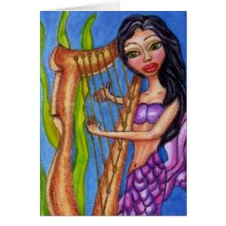 Sirène avec le carte pour notes d'harpe