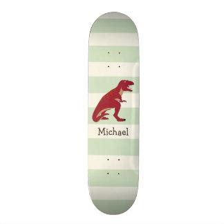 Skateboard T-Rex rouge sur les rayures vertes en pastel