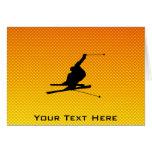 Ski jaune-orange de neige carte de vœux