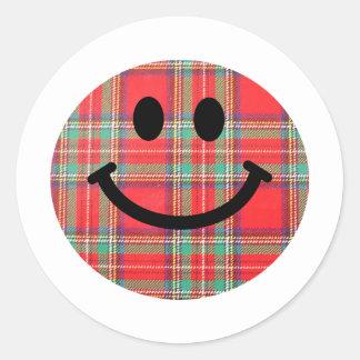 Smiley d'écossais de tartan sticker rond