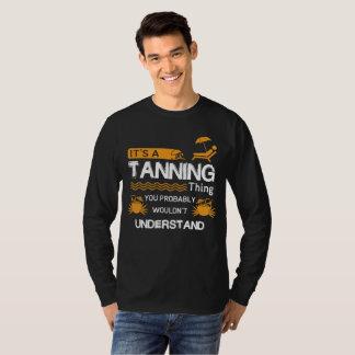 Son T-shirt de bronzage de chose d'A