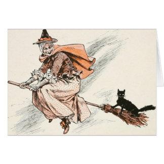 Sorcière vintage avec la carte de balai et de chat