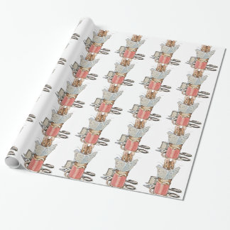 Souris de tailleur sur la bobine du fil papier cadeau