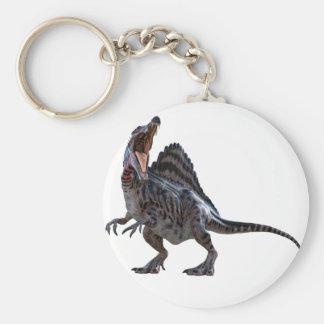 Spinosaurus s'accroupissant et regardant vers la porte-clé rond