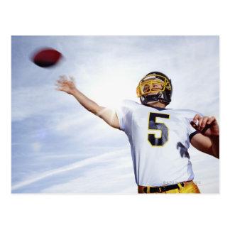 sportif jouant avec la boule de rugby cartes postales