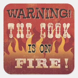 Sticker Carré Avertissement ! Le cuisinier est sur le feu