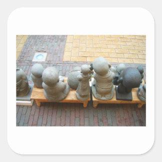 Sticker Carré Bébé néerlandais Buddhas de photographie dans une