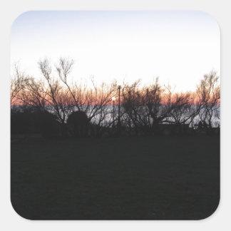 Sticker Carré Coucher du soleil de mer avec la silhouette