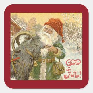 Sticker Carré Jultomten alimente à chèvre de Noël un biscuit