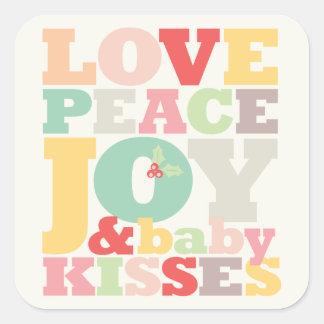Sticker Carré Le bébé de joie de paix d'amour embrasse le ęr