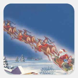 Sticker Carré Noël vintage, Père Noël pilotant le renne de