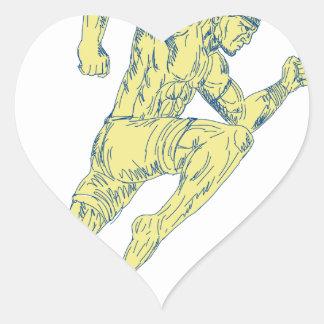 Sticker Cœur Combattant thaïlandais de Muay donnant un coup de