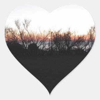 Sticker Cœur Coucher du soleil de mer avec la silhouette
