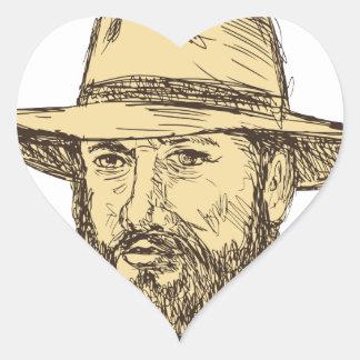 Sticker Cœur Dessin barbu de tête de cowboy