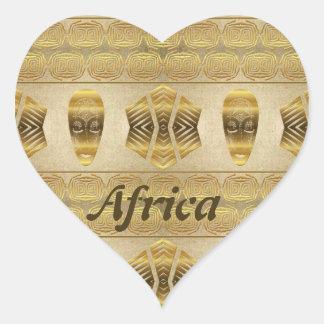 Sticker Cœur L'Afrique d'or. Modèle d'or de masque tribal