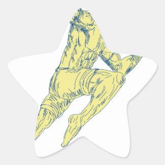 Sticker Étoile Combattant thaïlandais de Muay donnant un coup de