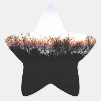 Sticker Étoile Coucher du soleil de mer avec la silhouette