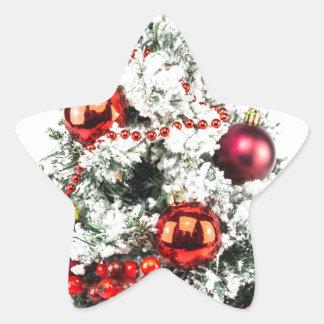 Sticker Étoile Peu arbre de Noël décoré avec des babioles