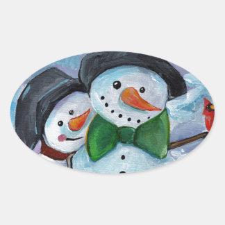 Sticker Ovale Bonhommes de neige de visite cardinaux