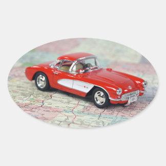 Sticker Ovale Corvette rouge sur la carte de route