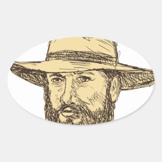 Sticker Ovale Dessin barbu de tête de cowboy