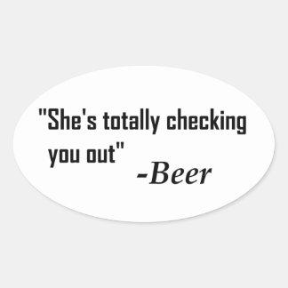 """Sticker Ovale """"Elle vous vérifie totalement"""" - bière"""