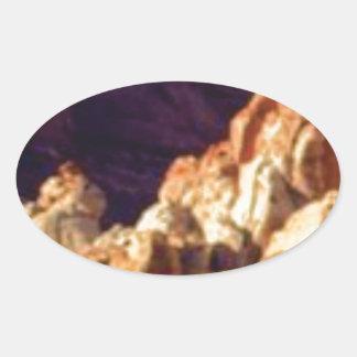 Sticker Ovale formations de roche rouges dans la pierre