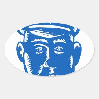 Sticker Ovale Gravure sur bois en tête de policier