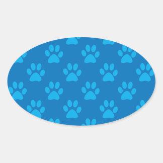 Sticker Ovale Motif bleu de pattes de chiot
