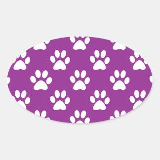 Sticker Ovale Motif pourpre et blanc d'empreintes de pattes