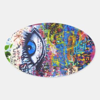 Sticker Ovale Oeil mauvais de graffiti bleu