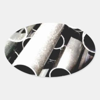Sticker Ovale pile de tubes en métal