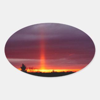 Sticker Ovale Pilier du feu au coucher du soleil, île de St