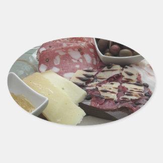 Sticker Ovale Plateau des coupes froides avec le prosciutto