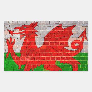 Sticker Rectangulaire Drapeau du Pays de Galles sur un mur de briques
