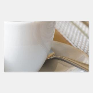 Sticker Rectangulaire Petite tasse de café express sur une soucoupe avec