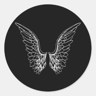 Sticker Rond Ailes blanches d'ange sur l'arrière - plan noir